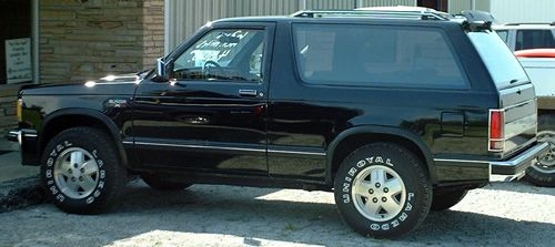 1985 Chevy S10 Blazer.  Mine was dark blue with a silver rocker panel and came with the Outdoorsman package, an option for 1985