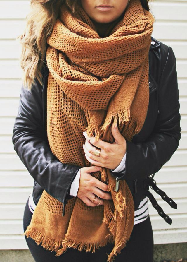 Leather moto jacket + oversized scarf.