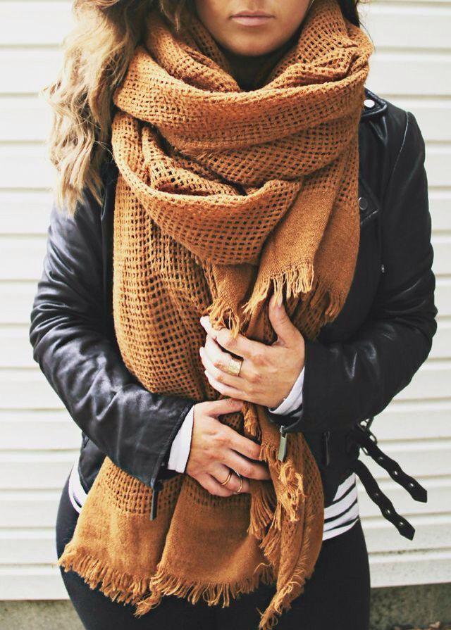 Leather moto jacket + oversized scarf.