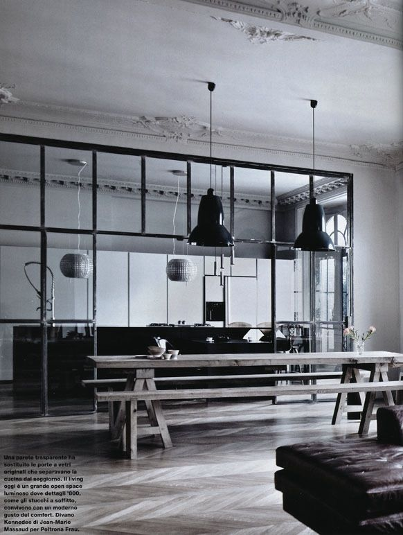Magnificent monochrome kitchen/dining space. Love the lighting, the floors, the furniture, the steel and glass room partition. It's all stunning.