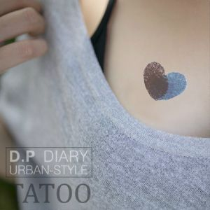 fingerprint tattoos of children, add their dates on each side.