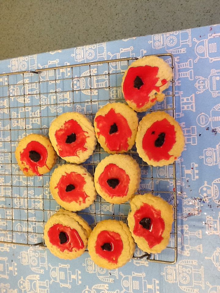 Poppy Biscuits for Remembrance Day  Egg free recipe: 115g butter 175g plain flour 55g caster sugar 2.5 tbsp cold water Vanilla extract  Bake at Gas Mk 2/150c  Icing is just icing sugar, water and colouring with black ready to roll in the centre.