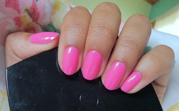 Essie pink polish. This is super feminine with short, round nails.