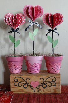 instead  of  flower pot spray  tin can then flower shape paper with heart center and shreaded green paper or easter grass. inexpensive  and simple  for little  kids to put together.