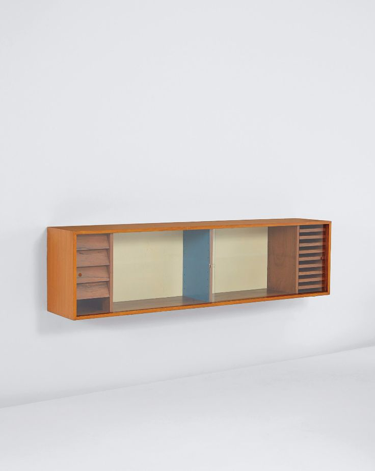 Finn Juhl; Mahogany, Rosewood, Painted Wood and Glass Wall-Mounted Cabinet, c1937.