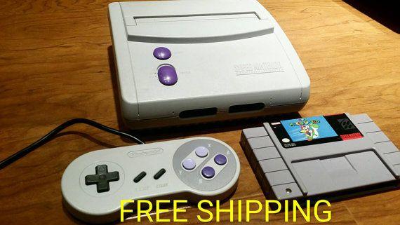 Super Nintendo bundle with Mario world  Etsy listing at https://www.etsy.com/listing/248432121/super-nintendo-console-snes-console