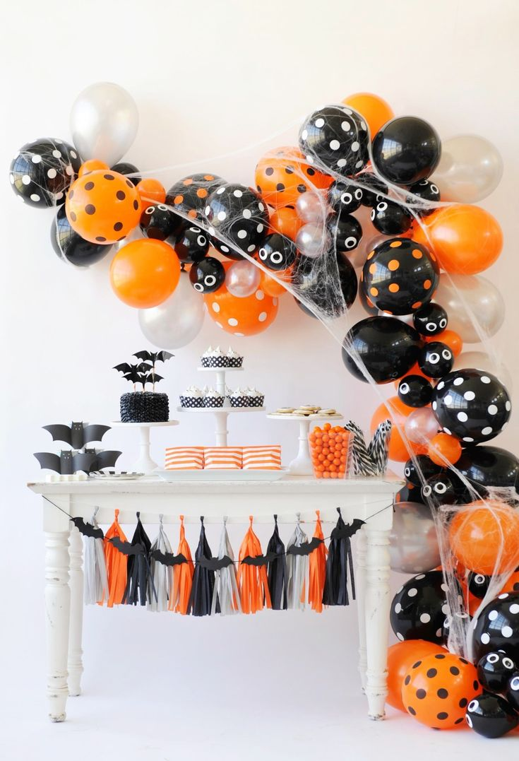 Kids Halloween Party Ideas - love the use the balloon arch covered in spider webs!