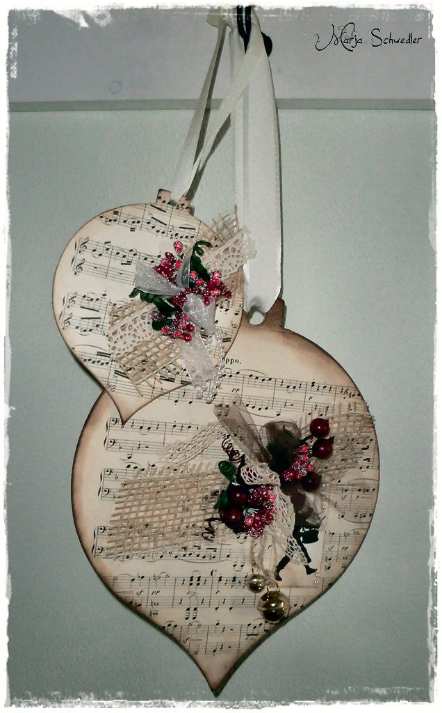 Christmas ornaments with old sheet music and embellishments!!! Be bee'!!! These paper ornaments would be great on the top of a gift as decoration!!!