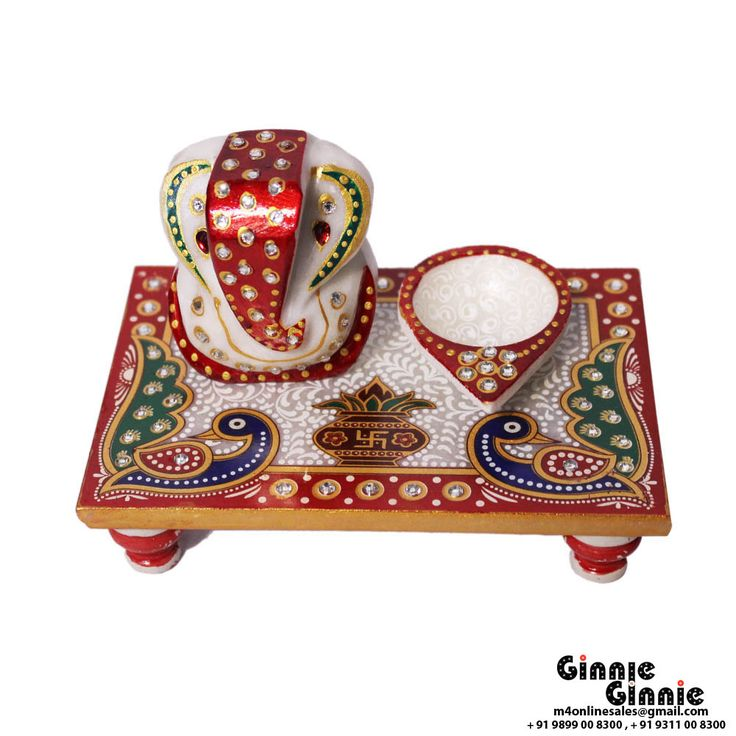 This Ginnie & Ginnie Exclusive Marble Chowki Ganesh with diya is a product from our Statue & Sculptures Collection. It is made of Marblestone and it got Meenakari finish on it. Its approx LxWxH is 6x4x4 inches. It is of approx 670 grams. Unique Code of this product is M400416.06