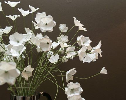 "How to Make Simple White Paper Flowers - CraftStylish great for fillers in those baskets, made from a 3"" circle!"