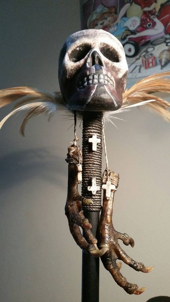 Baron Samedi wooden staff. Staff has real chicken feet and aged bones, chicken and pheasant feathers, and beads. Skull is aged painted *styro foam. Measures 24 in length. Hand made. Made to Order approximately 1-2 weeks. Please note: *Some supplies may be dependent on season and