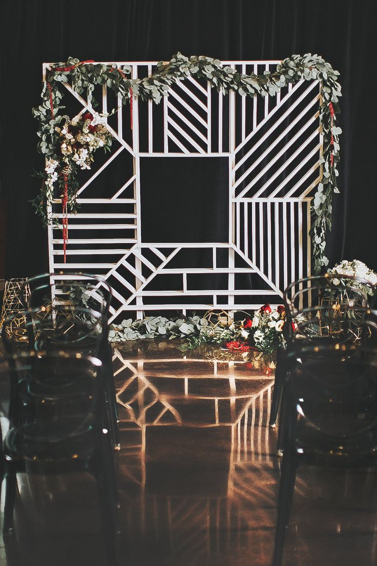 This geometric wedding backdrop is perfect for a modern wedding theme. Paired with romantic florals it made the perfect focal point for a chic New Year's Eve wedding inspiration shoot. See this and more beautiful details on Bridalgush.com  Flowers: The Flowerman www.flowermanflowers.com