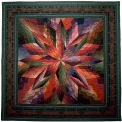 Sundance, a quilt by Jinny Beyer.  In her book Color Confidence for Quilters.  Well worth looking at as closely as you can to see how MANY different shades and colors contribute to the life and liveliness of this quilt.