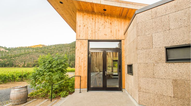 Exterior of the tasting room at Cowhorn Vineyard. Green Hammer Architect, Erica Dunn, designed the tasting room to meet Living Building Challenge petal certification - the first tasting room in the world to achieve this goal - and incorporated the same Passive House standards the residence will be certified under. 2YokeDesign provided interior design.