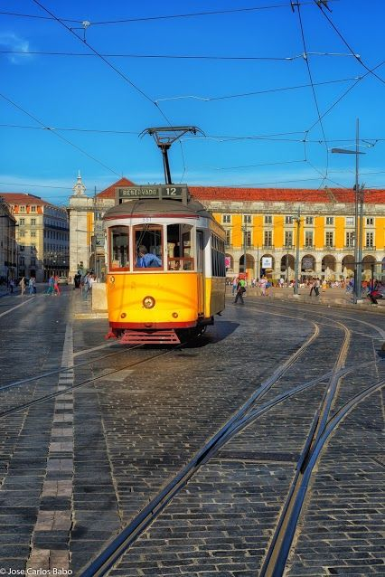 Old trams in Terreiro do Paço square - Lisbon, Portugal