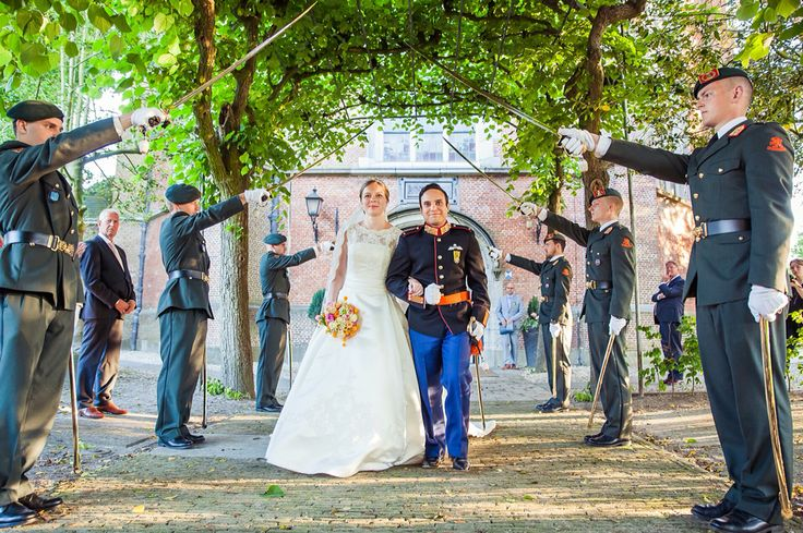 Military wedding with swords. Made by FOTOZEE