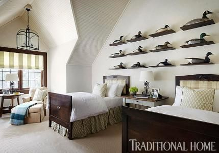 Duck decoys are a fun collection in a cabin. A large collection doesn't overwhelm in this room with a lofted ceiling. - Traditional Home ® / Photo: Werner Straube / Design: Kara Adam