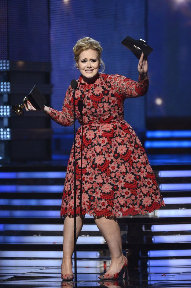 When she struck this adorable pose. | The 21 Most Adorable Adele Moments At The Grammys
