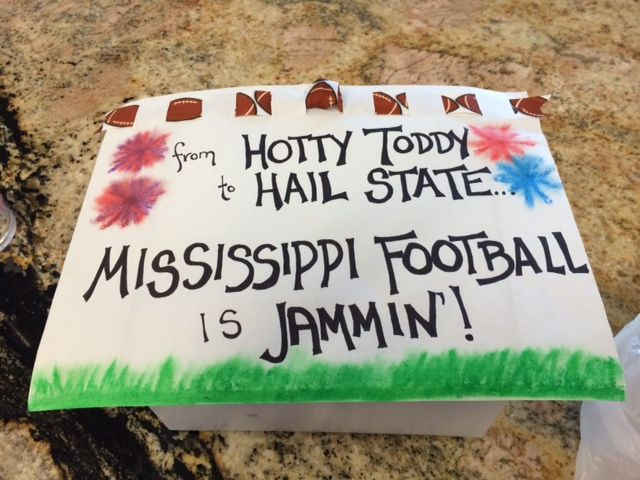 My neighbor gave me this after Mississippi State and Ole Miss vaulted to the top of the college football polls! Inside is a Southern Jam Cake. YUM!