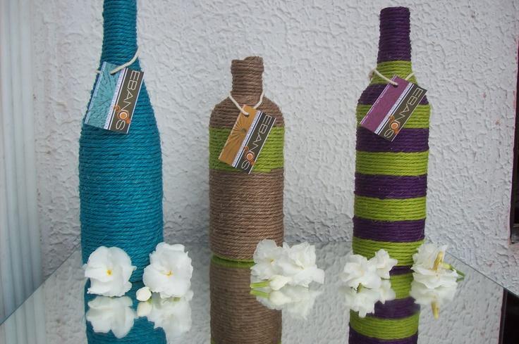 Botellas decoradas con fibras naturales decoraciones - Decoracion con botellas ...