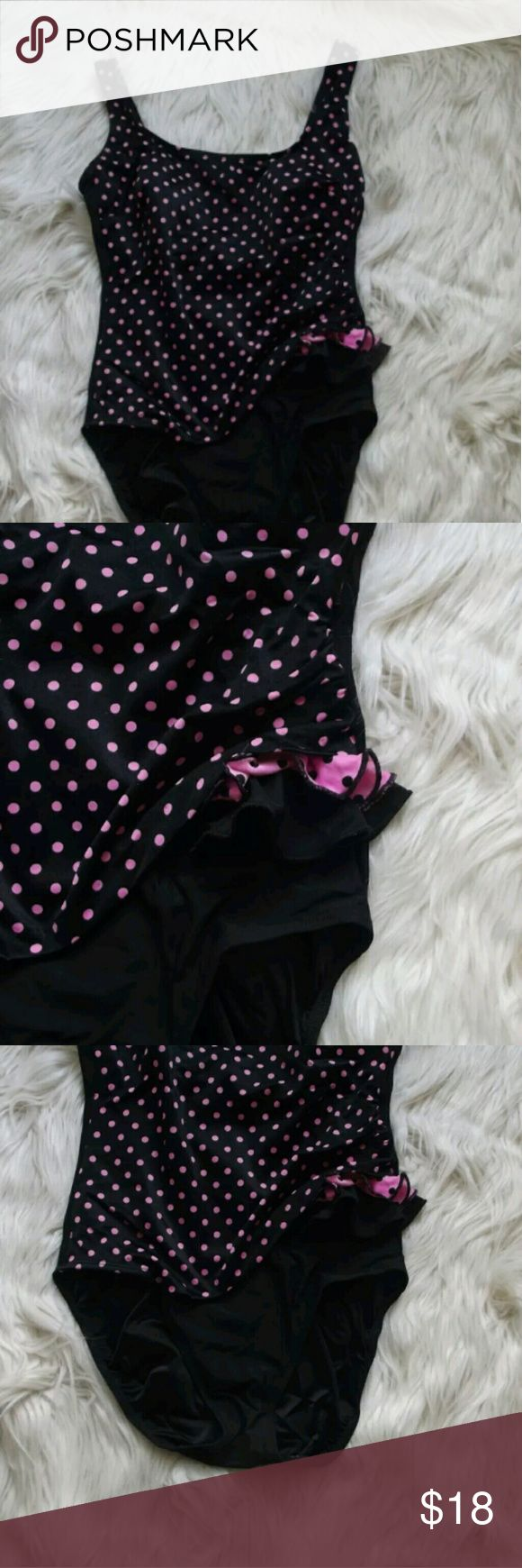 Longitude Black Polka Dot One Piece Bathing Suit Longitude Black & Pink Polka Dot One Piece Bathing Swimsuit ?Womens Size 10  In good condition. Has side ruffle detail that adds flair. Polka dot overlay on front of suit. Built in wire free bra. 85% nylon 15% lycra. Hand wash cold.?  Measurements Flat:  Pit to Pit: 17 inches  Length: 29 inches longitude  Swim One Pieces