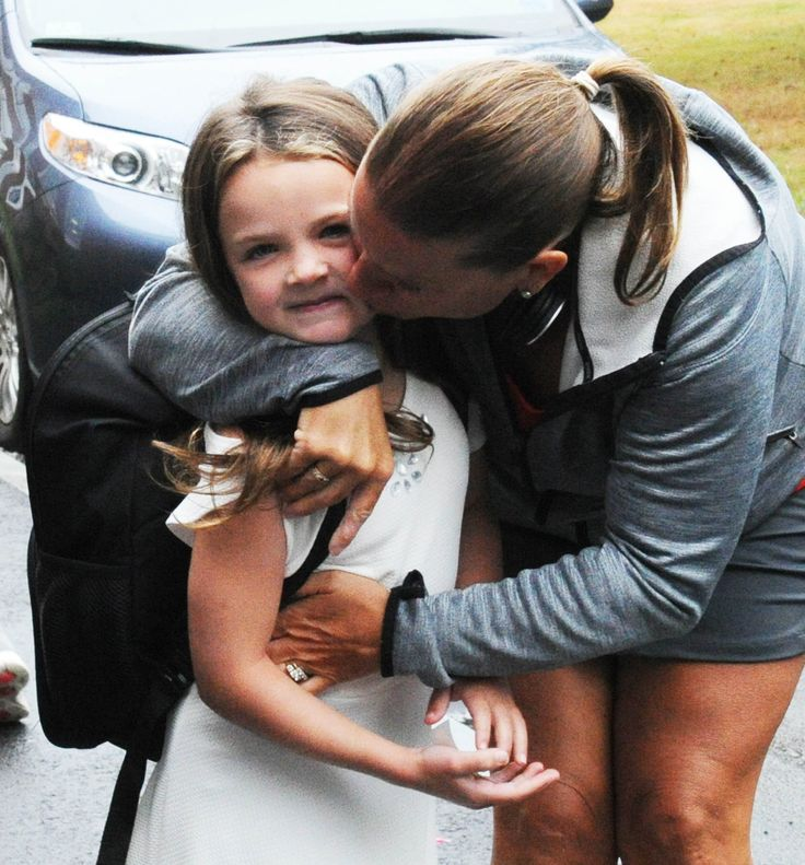 Malissa Chelmo kisses her daughter Maddison, 6, during the first day of school at the Central Elementary School in East Bridgewater on Wednesday, August 30, 2017. (Marc Vasconcellos/The Enterprise).