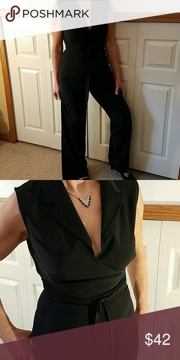 "NWOT Black Jumpsuit Newport News Never worn Newport News black Jumpsuit has a side zipper and is an actual wrap tie. The plunged neckline is totally feminine.  Polyester with 3% Spandex is a dressy smooth fabric with a wider leg. Size runs small. Great evening wear. Inseam 31 1/2"". Newport News Pants Jumpsuits & Rompers"