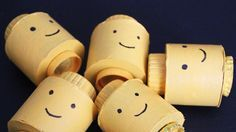 lego head made from toilet paper roll - what a cute way to make a lego minifigure party favor!