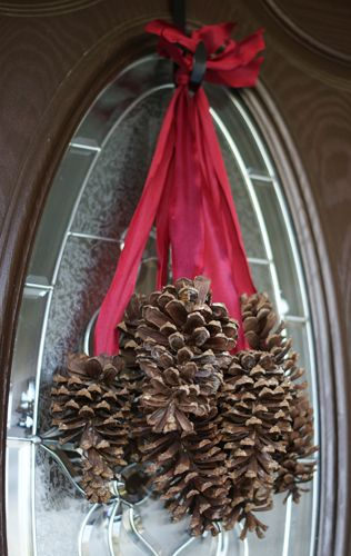 Hanging pinecones  Wreath alternative  I have all the cones needed plus ribbon.  How simple and beautiful.
