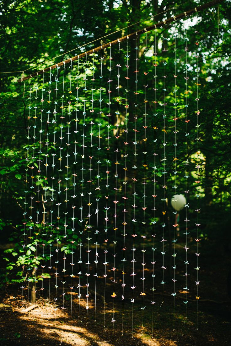 Origami Paper Crane Wedding Decor - Richard Skins Photography | Outdoor Tipi Wedding at Ecclesall Woods in Sheffield | Rustic DIY Decor | Bride in Short Blue By Enzoani 'Danbury' Dress | Badgley Mischka Kiara Shoes | Ted Baker Bridesmaid Dresses