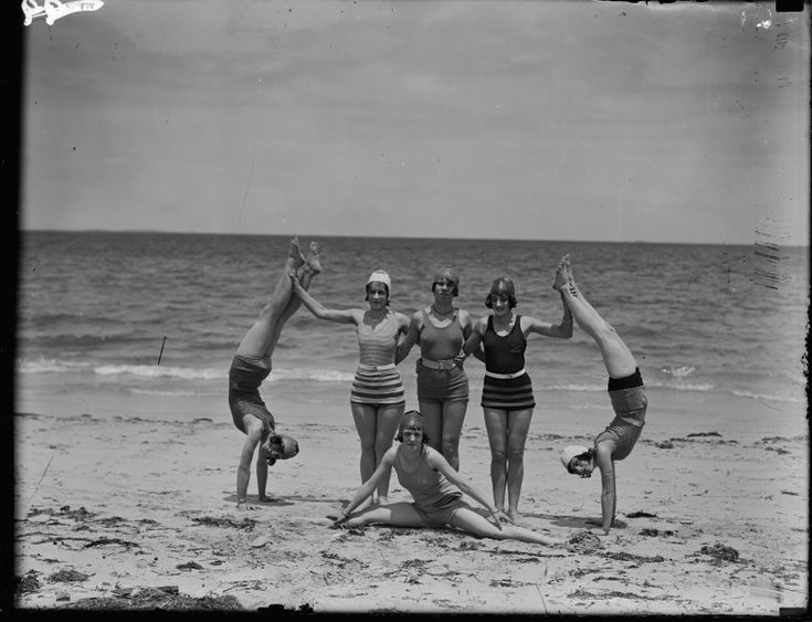 041367PD: Chorus girls of regular nightly stage show at Princess Picture Theatre, Fremantle, at Cottesloe Beach, ca.1929. Woman standing in white cap is Lillian Kelly, doing handstands are her daughters Amy and Sylvia of the Kelly School of Dancing https://encore.slwa.wa.gov.au/iii/encore/record/C__Rb1750419