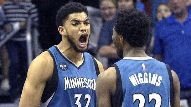 #NBA Minnesota Timberwolves center Karl-Anthony Towns (32) celebrates with guard Andrew Wiggins (22) after Towns blocked a shot by Orlando Magic forward Tobias Harris (12) at the end of regulation to send the game into overtime during an NBA basketball game in Orlando, Fla., Wednesday, Nov. 18, 2015. The Magic won 104-101. (AP Photo/Phelan M. Ebenhack)