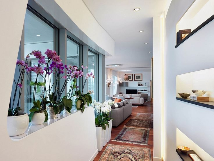 Apartments:Cool Hallway Of Luxury Apartment In Milan With Beautiful Flowers And Potted Plants Also Charm Rugs On Laminate Floor Also With Open Shelves Also White Wall Also Gray Sofas In Living Room Modern Interior Design of Luxury Apartment in Milan To Inspire You