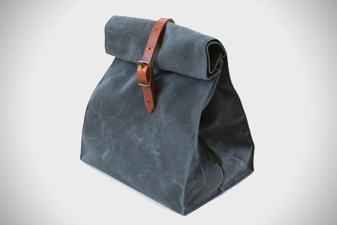 Overlap Sewing Studio Waxed Canvas Lunch Bag - The bag is constructed from waxed canvas, meaning that it's fully washable. A leather strap and buckle will keep it closed, and it's available in a variety of different colors.