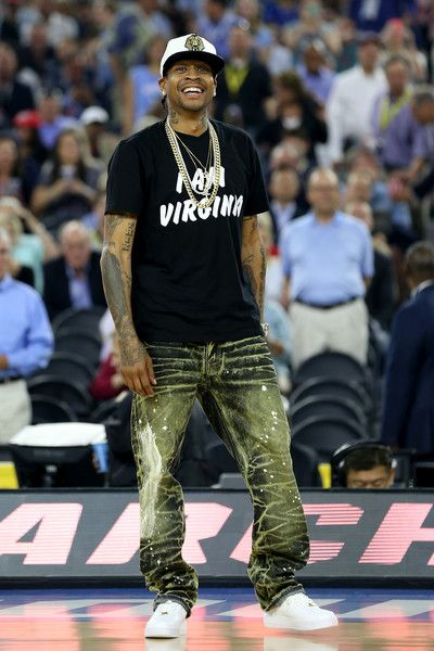 Allen Iverson Photos - Allen Iverson poses on the court as the Naismith Memorial Basketball Hall Of Fame 2016 Class is announced during a break in the 2016 NCAA Men's Final Four National Championship game between the Villanova Wildcats and the North Carolina Tar Heels at NRG Stadium on April 4, 2016 in Houston, Texas. - Naismith Memorial Basketball Hall of Fame 2016 on Court Class Announcement