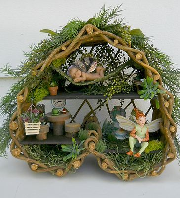Fairy House in upside down heart shaped twig basket. Ebay ID: heartsdesire56 This is a good use for those weird shaped baskets we all have!