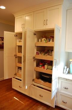 Pantry - sliding shelves--on both sides of the double fridge