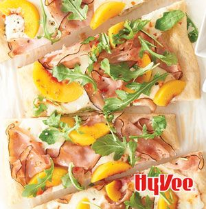 This pizza, oh this pizza. You might think you can only get Ham, Peaches and Arugula Pizza from one of those fancy pizza places. It just so happens that the fancy pizza place is your kitchen.