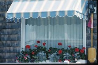A window awning is installed directly above a window on the exterior of a house. It helps keep shade over the window. Awnings are typically made with a metal frame and are composed of some type of fabric. The width and projection away from the house will vary depending on the size of window you have. If you want to make a stationary window awning,...