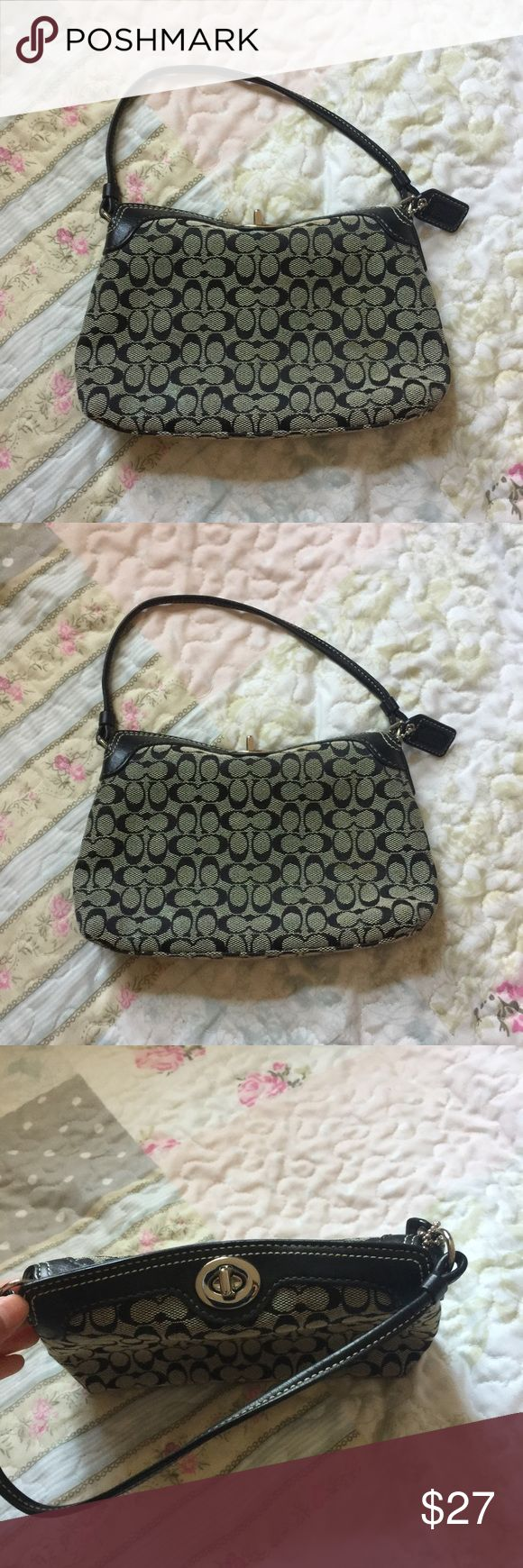 Coach mini hand bag Cute black and gray coach mini hand bag, great for a night out or even for a day look. Perfect accessory to add on to any outfit! Can fit a iPhone 6+ and 7+ Coach Bags Mini Bags