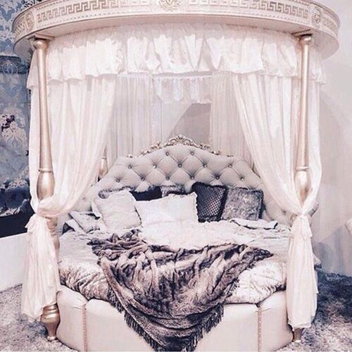 Beautiful bedroom. Tufted round canopy bed with fur accents.