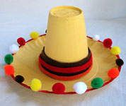 Paper plate, cup, felt and pom-poms to make sombrero for a kid craft! I would only paint plate and cup if I had time! Probably would buy colored plate and cup at dollar store.