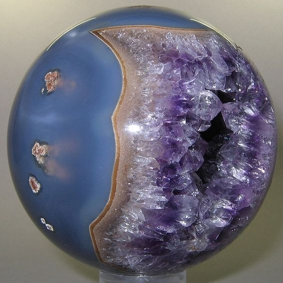 Polished mineral spheres at this site are amazing. This one is an Amethyst from Brazil <<< What a beautiful piece... I would love to have it... <3~R~<3