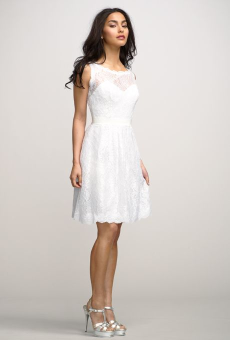Brides: Encore by Watters . Charming white bateau neck, sleeveless lace dress over white lining with a keyhole back, and lace covered buttons at back. Snow grosgrain ribbon belt at natural waist and shirred above the knee length skirt. Multiple lace and lining colors.. All grosgrain ribbon colors available.