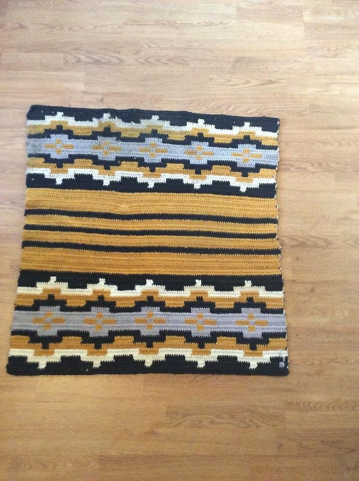 8 oz. Black 8 oz. Gold 4 oz. Gray 4 oz. Off-White The Wide Ruins area of the Navajo Reservation is known for very fine weaving in all vegetal dyes. These rugs contain stripes and bands across a borderless product. Designs normally include simplified forms of arrows, chevrons and squash blossoms. The blending of soft colors and small intricate designs is very soothing and recognizable. Each of our patterns are tested and proven. They are authentic designs that have been completed numerous…