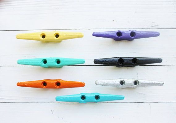 Nautical Home Decor Boat Cleats, Listing for 1 Boat Cleat.  Our great Boat Cleat Hooks were inspired by boating enthusiasts and designed to add nautically themed function to any space in your home. Use them to add a nautical touch to your bathroom or use them as drawer pulls. These wall decor CLEATS is made from Galvanized Iron , sturdy as they are eye-catching.   Picture # 1 ( Top to Bottom )  1. Buttercup Yellow 2. Sea Glass 3. Turquoise Blue 4. Bright Orange 5. Bright Purple 6. Jet Black…