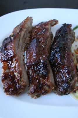 Asian Marinade Ribs - marinade in  hoisin sauce, sugar, soy sauce, rice vinegar, sambal oelek (ground chili sauce at your local Asian Market, use less if you don't want it as spicy),  garlic, ginger, cilantro, sesame oil for at least 8 hours and up to 24. Bake on low heat for several hrs. and enjoy these finger lickin good ribs.