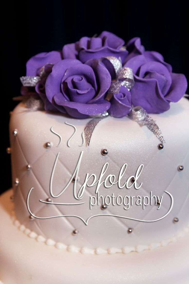 Elegant white wedding cake with pincushion effect and purple flowers. Absolute elegance and perfection for your special day. Image by Upfold Photography, Auckland. ~ Elegant wedding cake ~ white and purple wedding cake ~ pincushion effect with silver detail ~