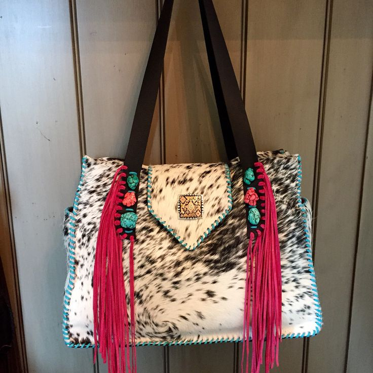 A white cowhide Bonnie bag from gowestdesigns.us. This customer sent her own hot pink and turquoise stones as well is a beautiful custom concho to customize her bag. This bag went to Texas.
