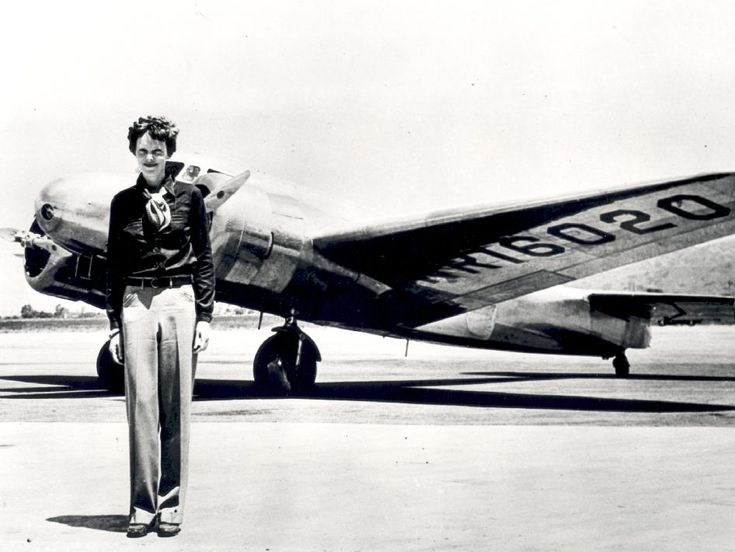This image shows Earhart standing in front of the Lockheed Electra in which she disappeared in July 1937.
